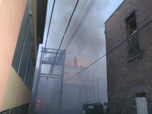 Smoke and flames in back alley Hume Alley